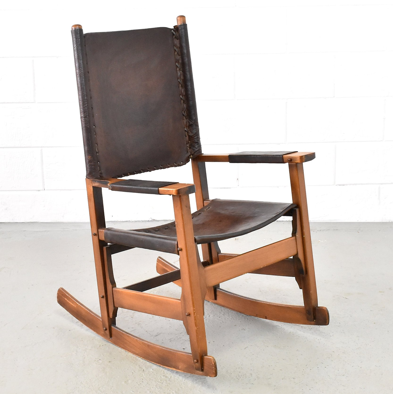 Patinated leather rocking chair produced by arte sano 1960s