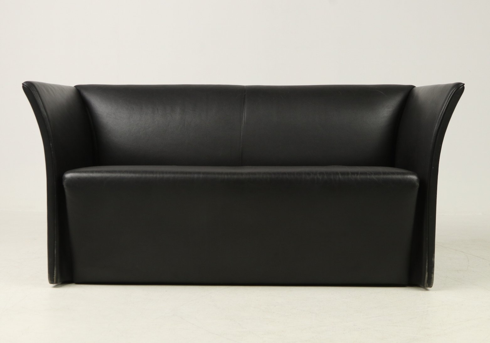 Modern design 2-seater sofa in black leather