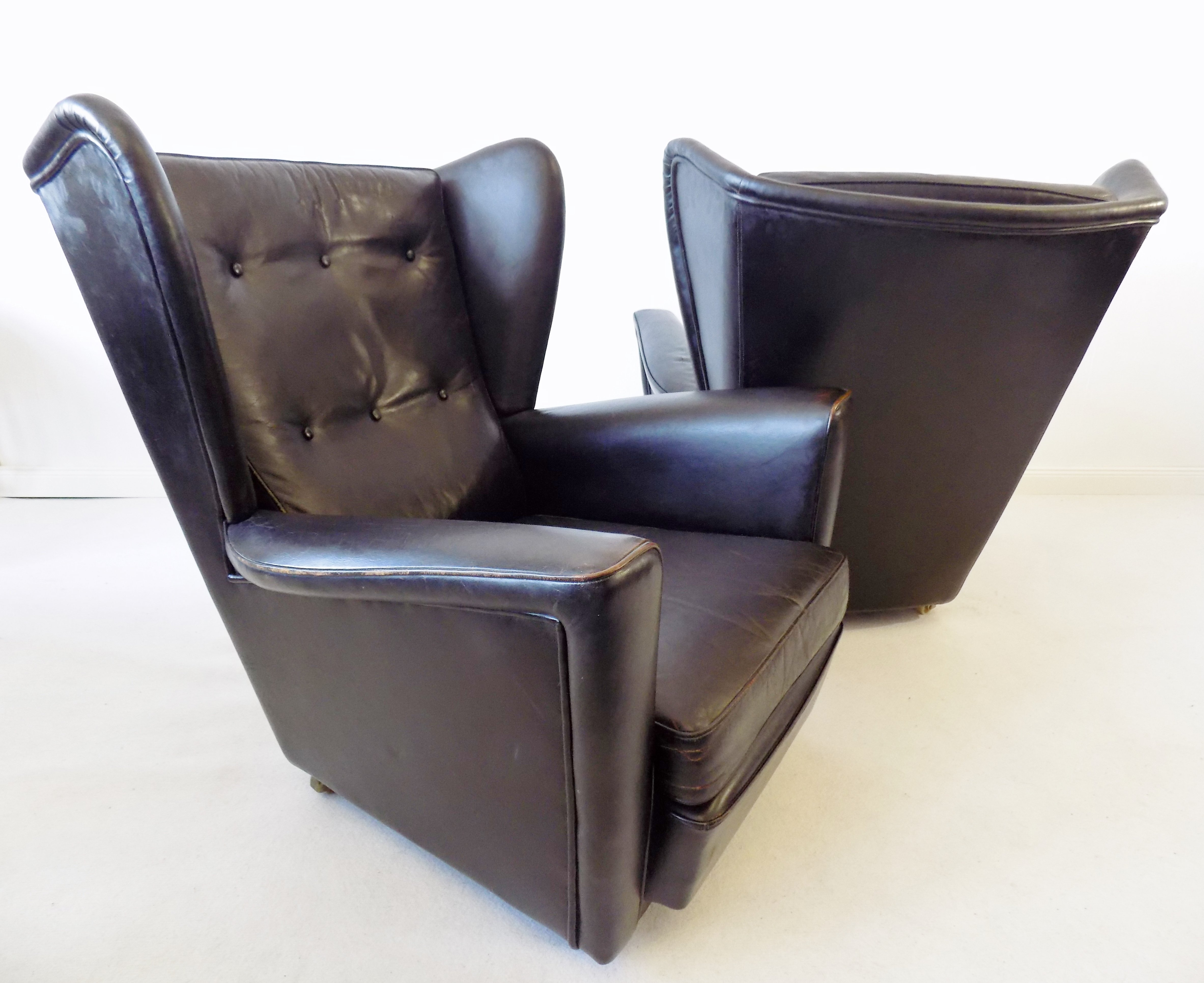 pair of black leather wingback chairs by howard keith for hk furniture