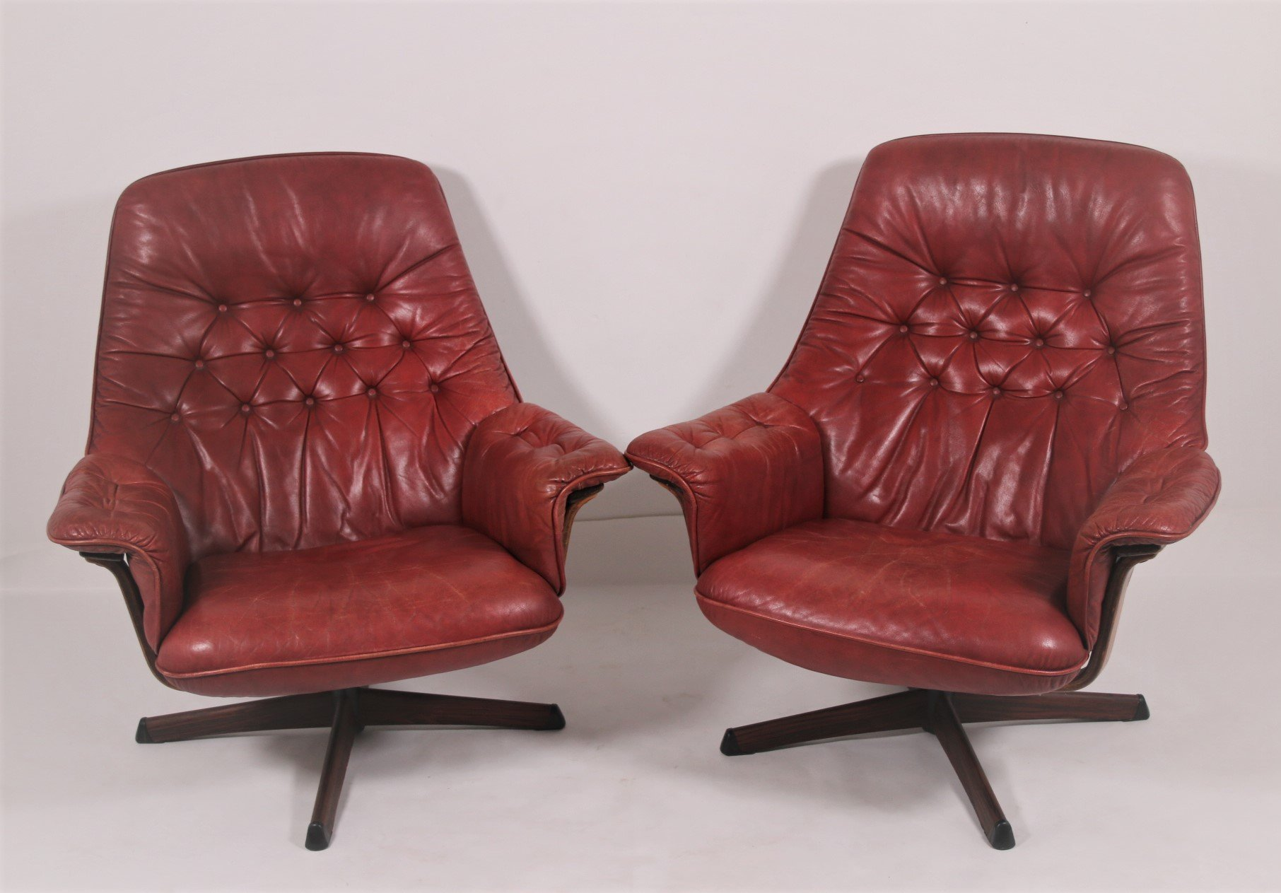 Pair Of Vintage Red Leather Swivel Armchairs With Wooden Accents 1960s 139872