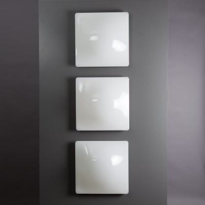 8 IP40 wall lamps from the seventies by Harvey Guzzini for Guzzini