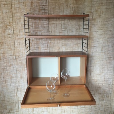 String wall unit from the forties by Nils Strinning for String Design AB