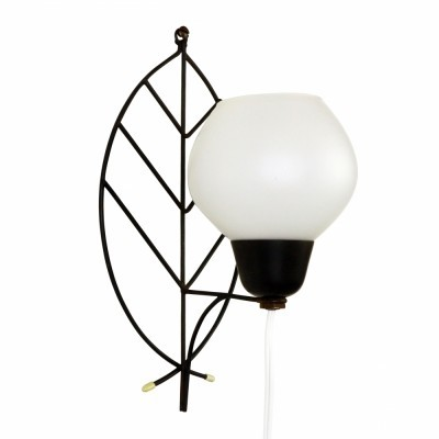 Decorative leaf inspired wall sconce from the sixties with a glass shade