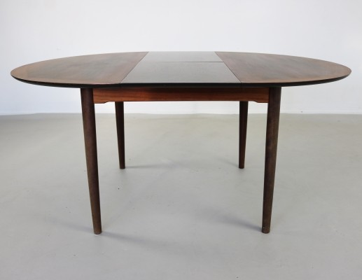Beautiful round dinner table with wooden inlays