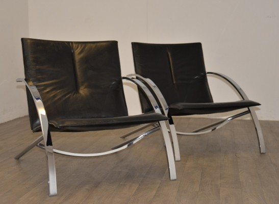 Pair of Arco arm chairs by Paul Tuttle, 1970s