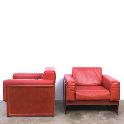 Red leather lounge chairs produced by Matteo Grassi