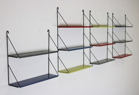Four colorful metal wall racks from the sixties