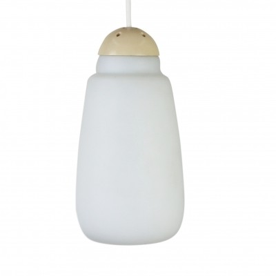 Milk glass pendant by Philips with a creme colored top