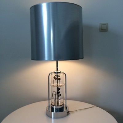 Kinetic lamp with movement of a mobile in the base