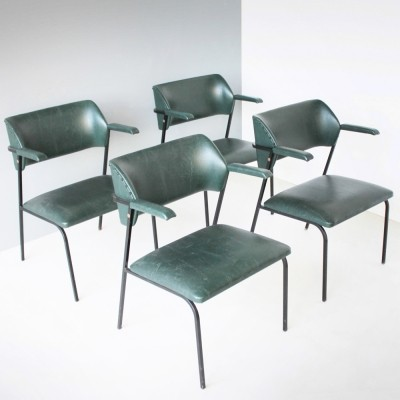 Four dark green faux leather chairs