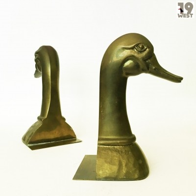 Two brass bookends from the 1970