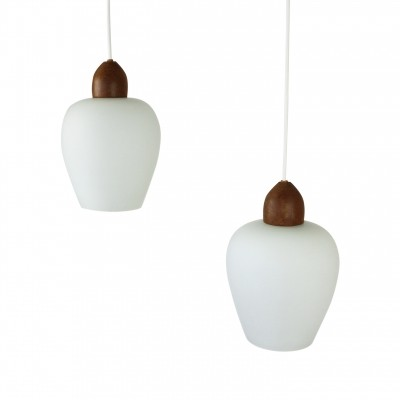 Pair of Scandinavian milk glass & teak pendants, 1960s