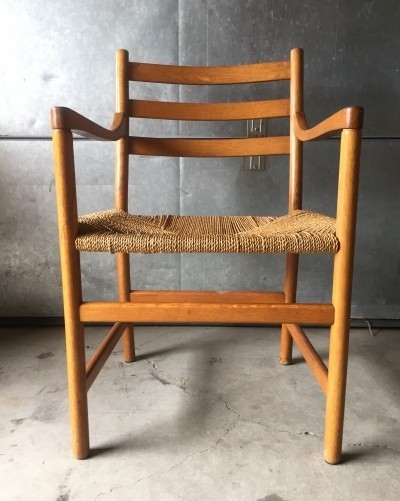 Danish oak armchair with cord seating, 1950s