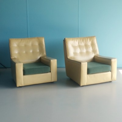 Two fifties XL faux leather lounge chairs