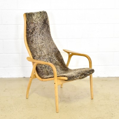Swedese Lamino easy chair in sheepskin designed by Yngve Ekström