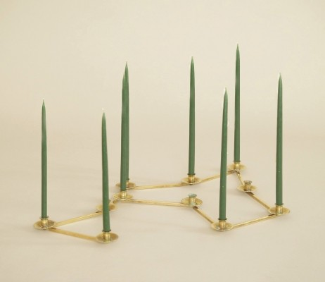 Articulated candle holder with 11 corolla-shaped heads, Sweden circa 1945
