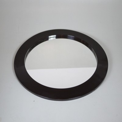 Minimalist Pop art style round wall mirror with a brown shaped frame in plastic