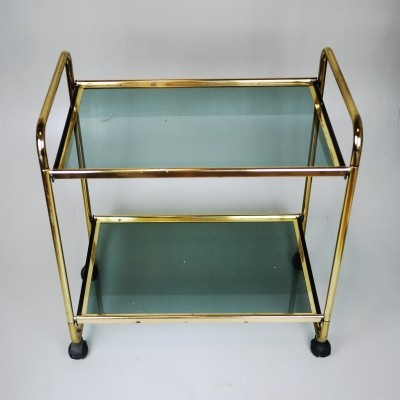 Late Mid-century table, golden structure with green glass on wheels