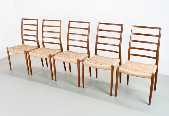 Niels Otto Moller model 82 dining room chairs in papercord & teak