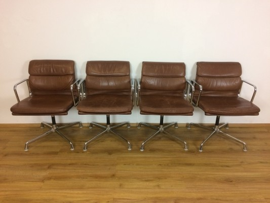 Cognac leather EA107 office chairs by Charles & Ray Eames for Herman Miller