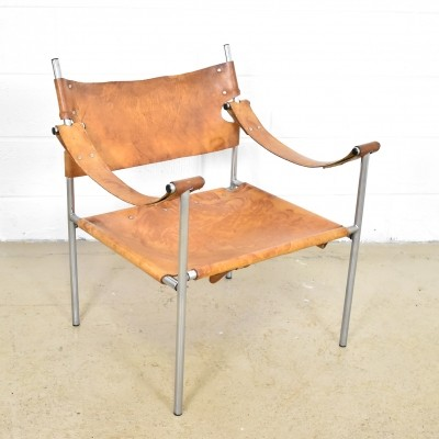 Chrome steel lounge chair with cognac saddle leather upholstery
