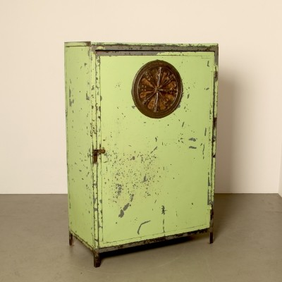 Factory cabinet with large antique ventilation grille