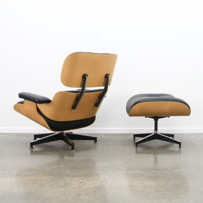 Black leather & oak veneer Eames lounge chair + ottoman, 1990s