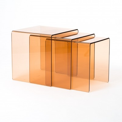Transparent Acrylic nesting tables in orange brown, 1970s