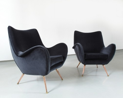A rare pair of sophisticated & dynamic shaped lounge chairs by Melchiorre Bega