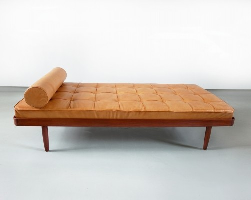 Daybed by Danish manufacturer Horsnaes executed in solid teak + aniline leather