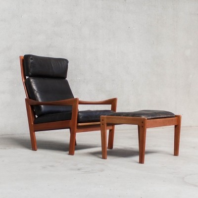Black leather lounge chair by Illum Wikkelso, Denmark