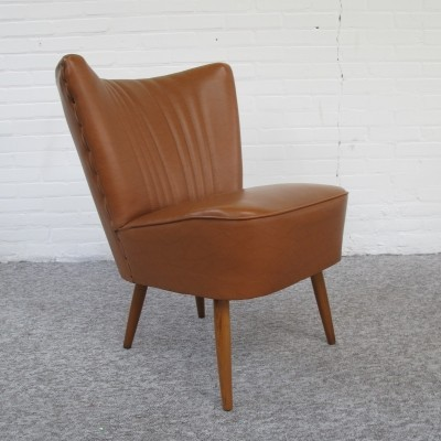 Two 60s Club armchairs