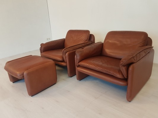 Set of two De Sede DS-61 lounge chairs with ottoman, 1970s