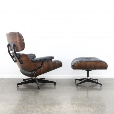 Eames lounge chair + ottoman in black leather/rosewood, 1960s