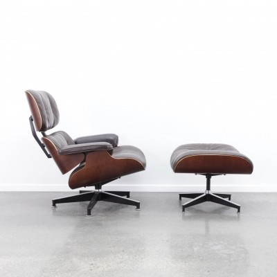 Eames lounge chair + ottoman in brown leather/cherry, 1980s