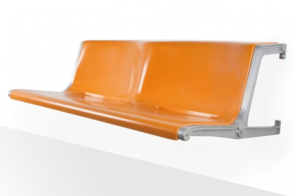 Wilkhahn 1200 bench by Friso Kramer in orange fibreglass on hanging consoles