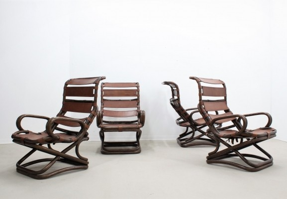 Set of 4 mid century curved rattan & leather armchairs by Tito Agnoli for Bonacina