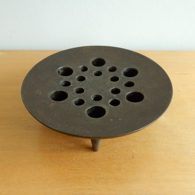 Cast iron candle holder by Jens Quistgaard