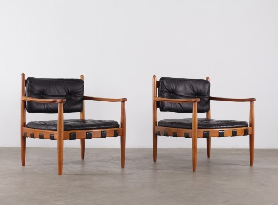 Pair of Eric Merthen 'Cadett' black leather armchairs