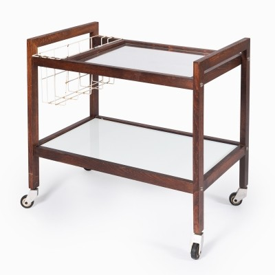Wooden serving table with glass on wheels