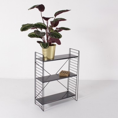 Freestanding metal rack by Tomado