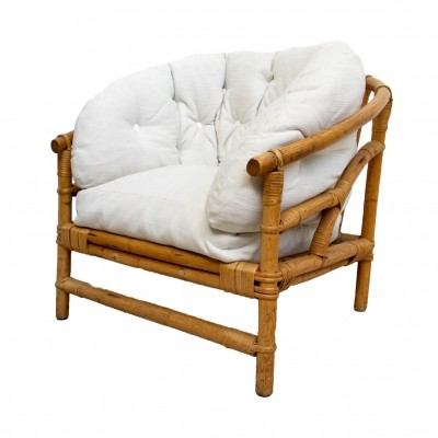 Rattan chair with reupholstered white cushions