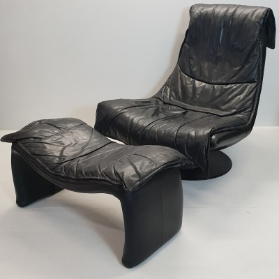 Black leather swivel chair with ottoman, 1980s