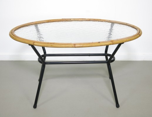 Rare oval shaped rattan table by Rohé Noordwolde, 1960s