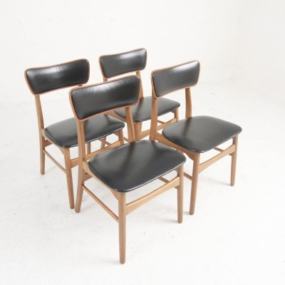 Four dining chairs in stain beech & teak upholstered with black leatherette