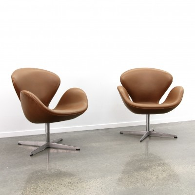 Pair of Cognac leather Swan chairs by Arne Jacobsen, 1990s