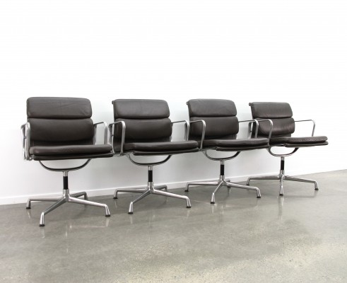 4 x Black leather Eames EA208 soft pad chairs, 1990s
