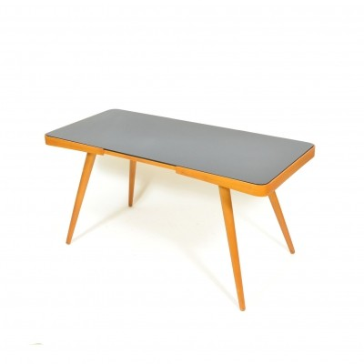 Coffee table by Interiér Praha in beech with black glass, 1960s