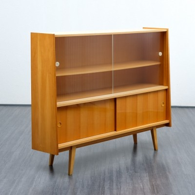 1950s streamline glass cabinet in cherrywood