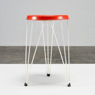 Metal hairpin stool by Pilastro